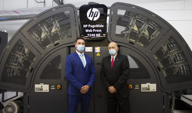 Pictured in front of Africa's first HP Page-Wide Inkjet Digital Press are Print On Demand's MD, Tertius van Eeden, and Kemtek national sales executive, Pierre Driver.